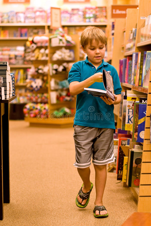 Boy holding book and walking