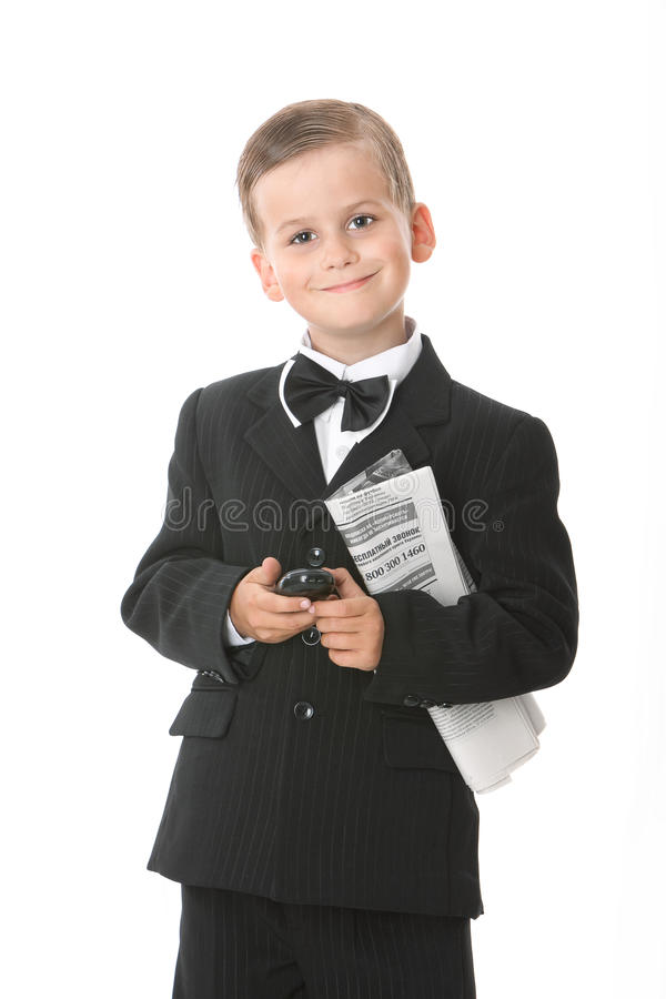 Boy holding a cellphone and newspaper royalty free stock image