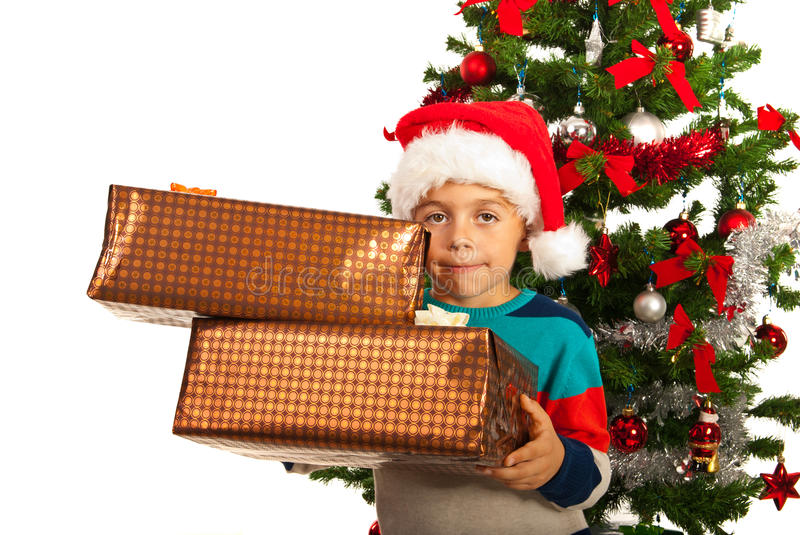 Boy holding Christmas gifts royalty free stock photography
