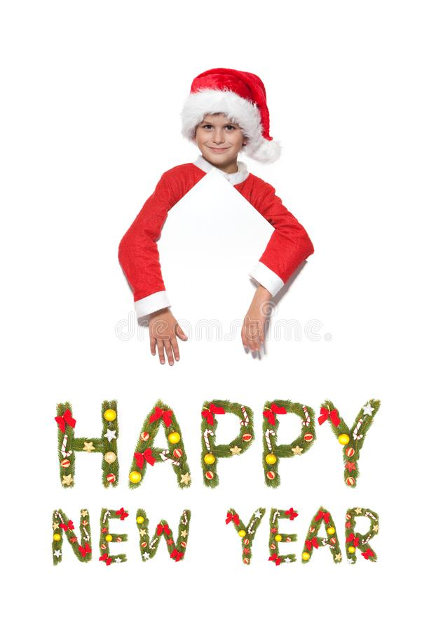 Boy holding a christmas poster stock images