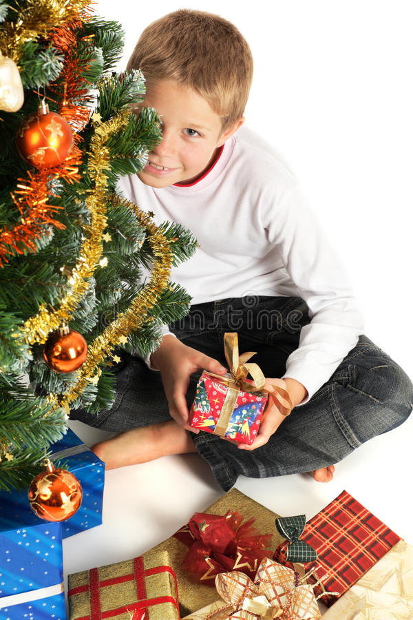 Free Boy Holding Christmas Present Royalty Free Stock Images - 10645479