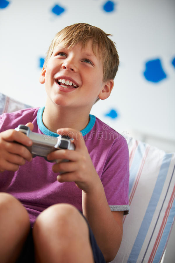 Boy Holding Controller Playing Video Game Stock Image