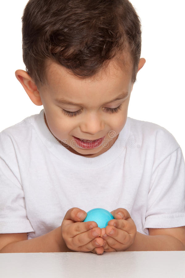 Download Boy Holding Egg stock image. Image of childhood, male - 19569475