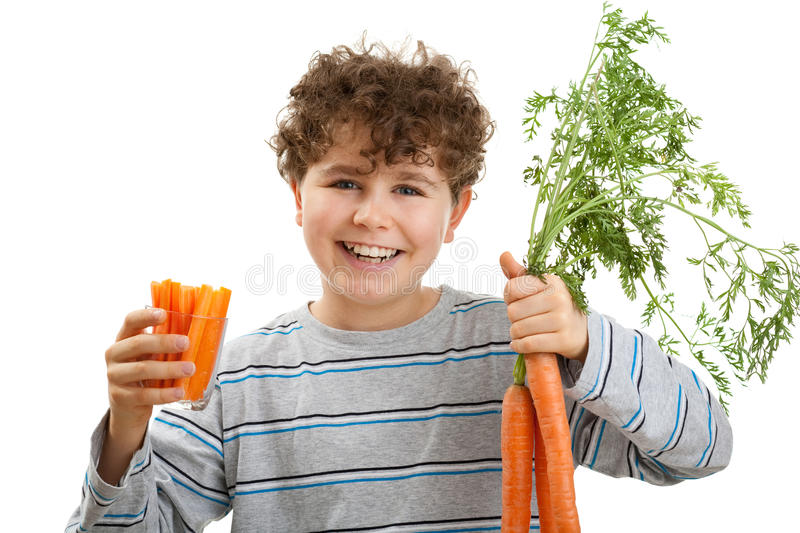 Download Boy holding fresh carrots stock image. Image of greens - 10932479