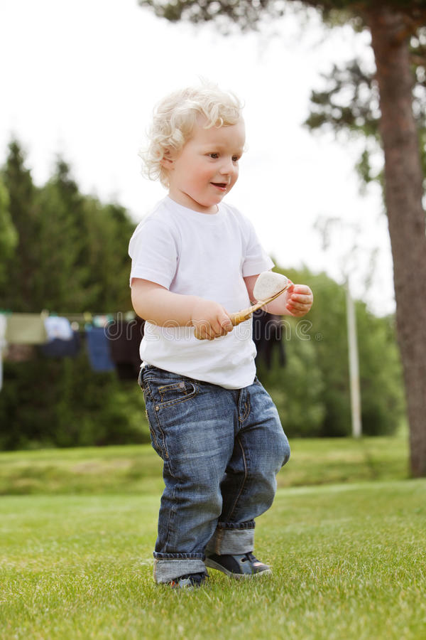 Boy holding gardening tool royalty free stock photo