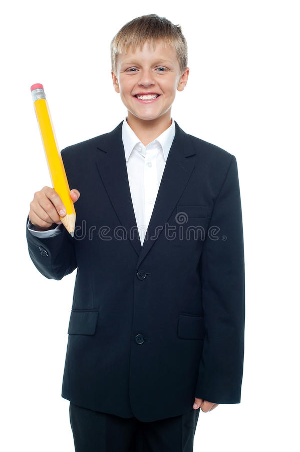 Download Boy Holding Giant Sized Yellow Pencil Stock Image - Image: 27260963