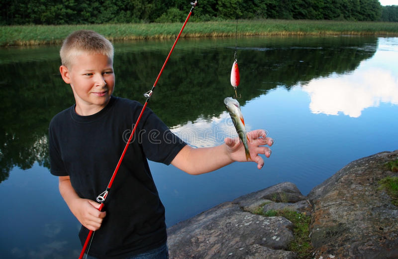 Download Boy Holding His Catch Royalty Free Stock Photography - Image: 28859187