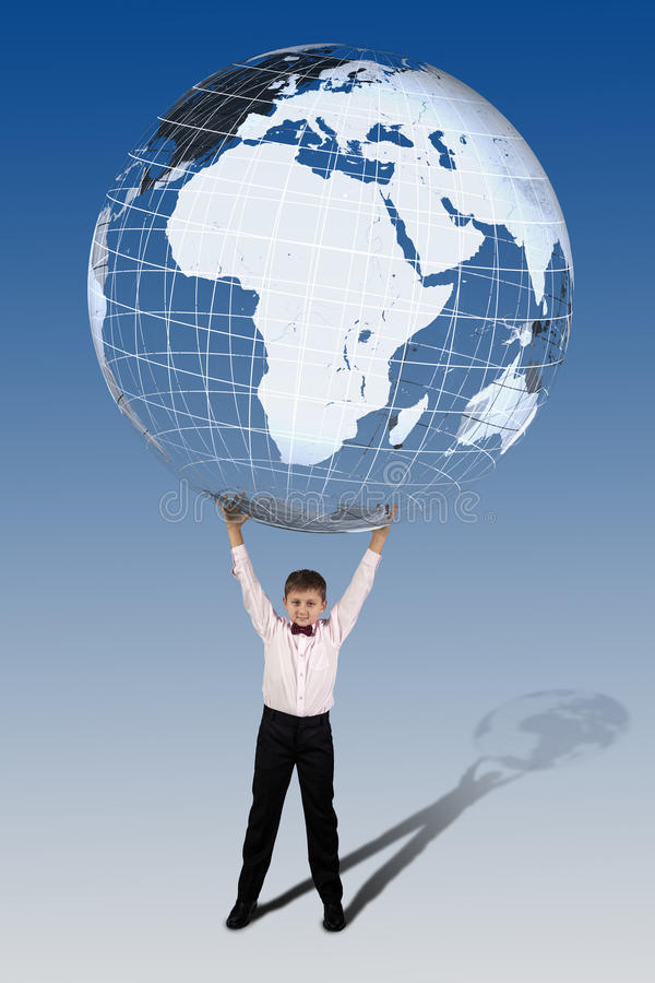 Boy holding in his hands over his head a large translucent globe stock image
