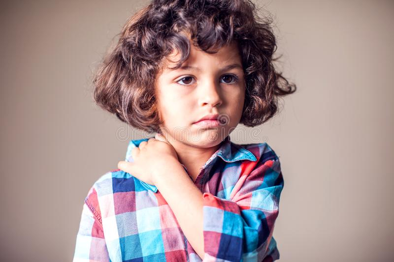 A boy holding his painful neck. Children, healthcare and medicine concept. A boy holding his painful neck. Children, healthcare, medicine concept royalty free stock photo