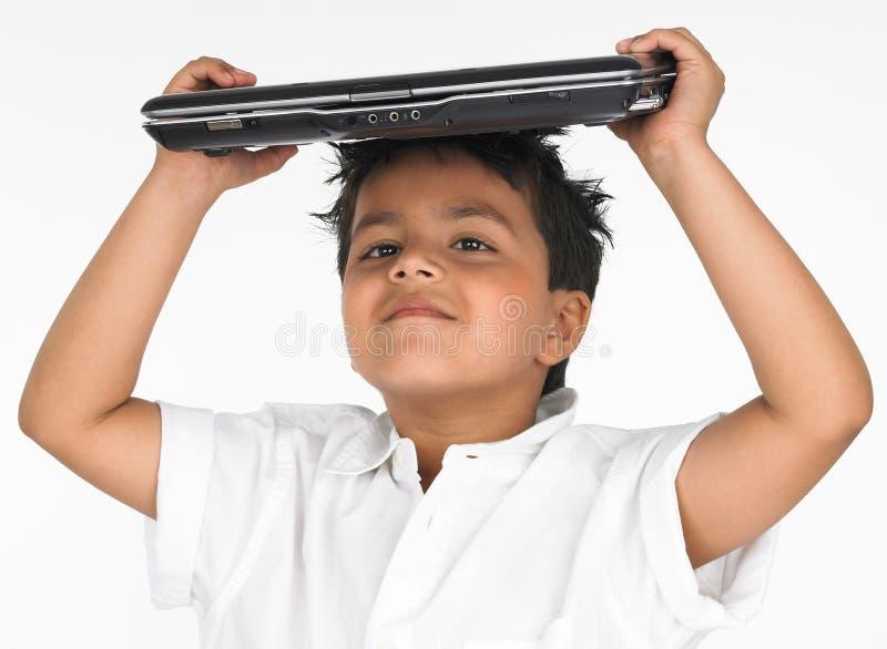 Boy Holding Laptop On His Head Stock Photos