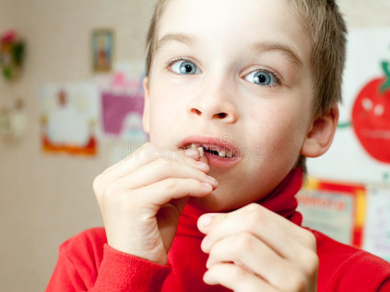 Boy holding missing teeth stock image