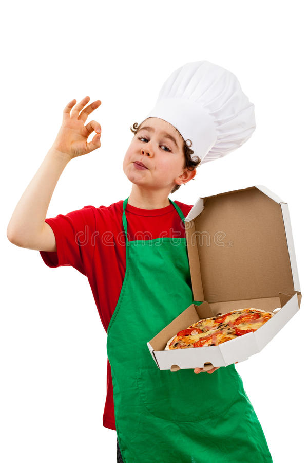 Boy holding pizza showing OK royalty free stock image