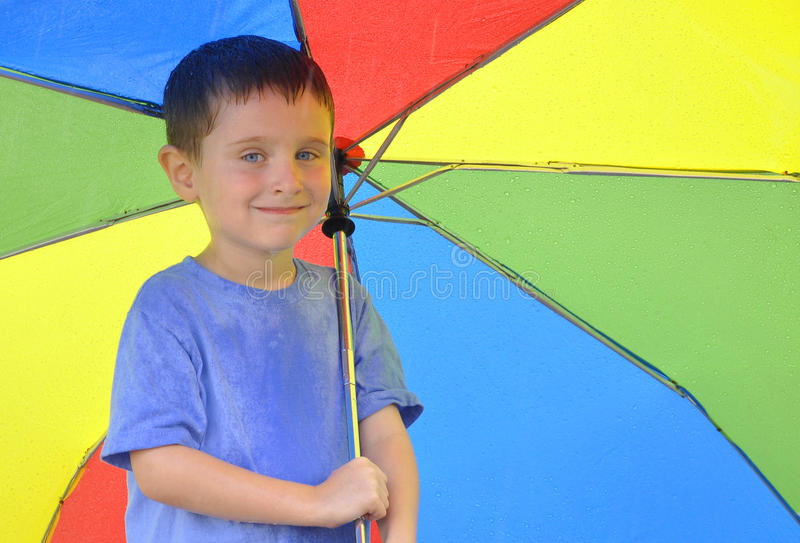 Download Boy Holding Rainbow Umbrella Stock Photography - Image: 26390702