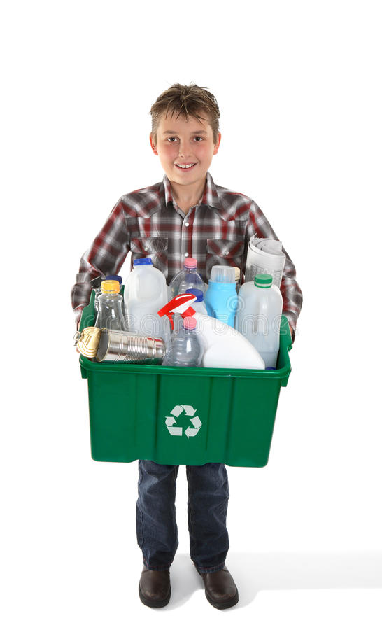 Boy holding recycling bin full or rubbish royalty free stock images