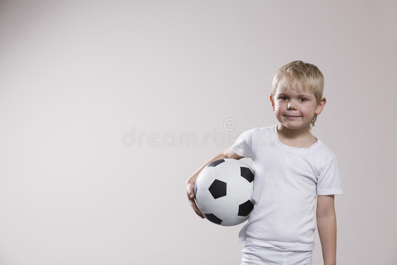 Boy Holding Soccer Ball royalty free stock images