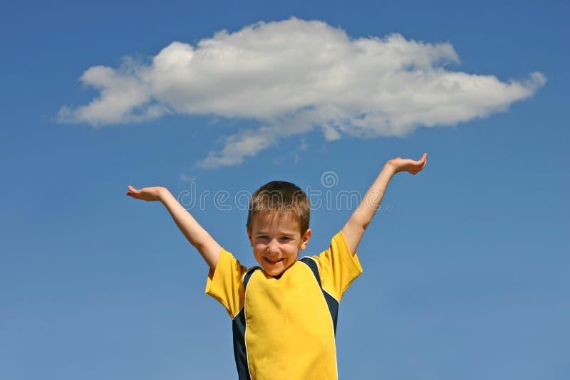 Boy Holding up A Cloud stock photos
