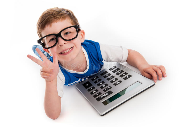 Boy Holding Up Three Fingers and a Big Calculator. stock image