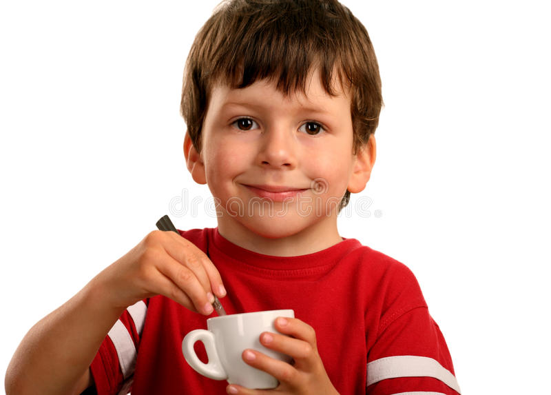 Boy holding a white cup royalty free stock photography