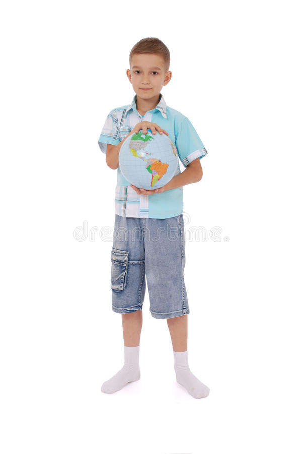 The boy holds the globe in hands stock images