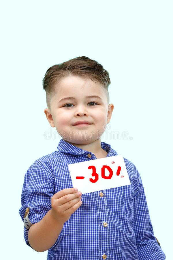 The boy holds a sign with a percentage of discounts stock image