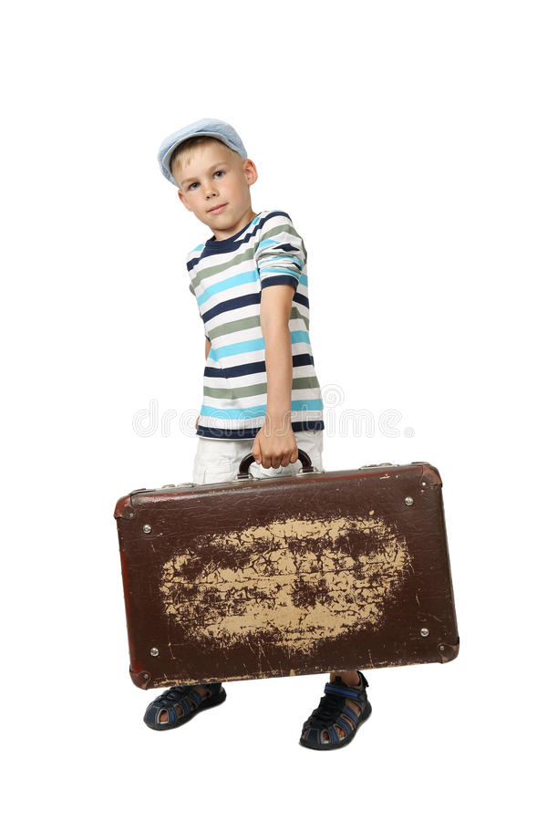 Boy holds vintage suitcase in hand royalty free stock image