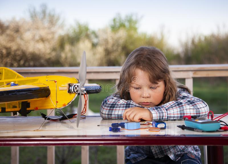 Boy with homemade radio-controlled model aircraft airplane is hand made not copyright stock photos