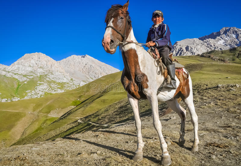 Boy with horse in Kyrgyzstan stock photos