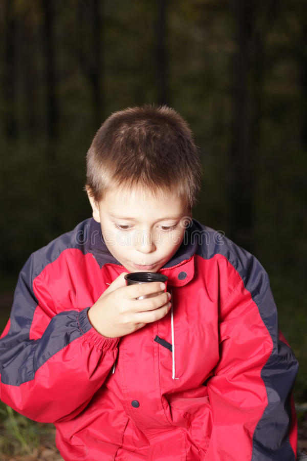 Download Boy With Hot Drink In Dark Forest Stock Photo - Image: 11787840