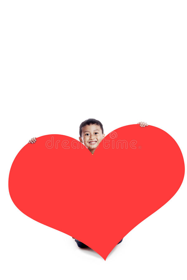Boy with a huge heart cutout