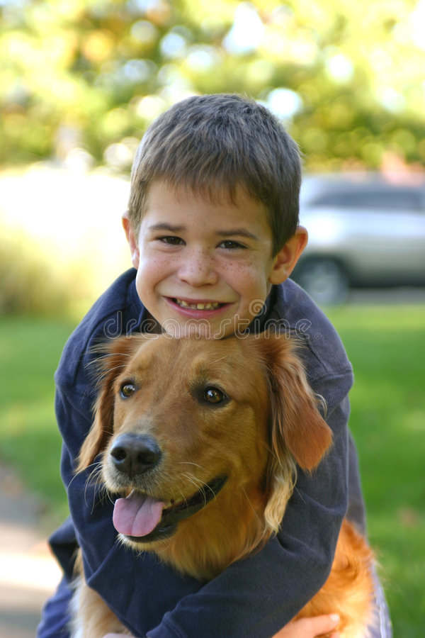 Boy Hugging Dog stock photos