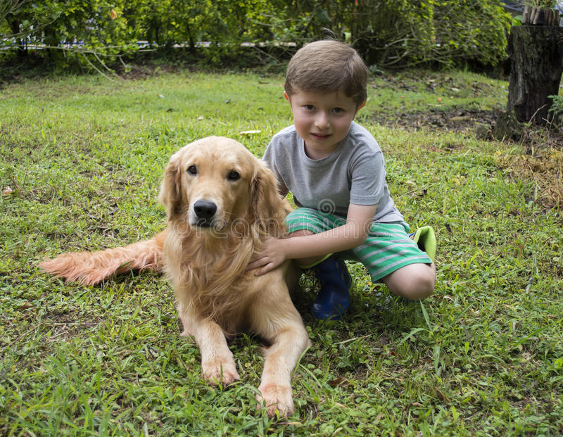 Boy Hugging the Dog. Boy Hugging the Dog in the Fall royalty free stock photo