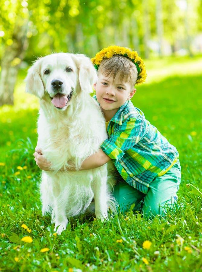 Boy hugging golden retriever royalty free stock image