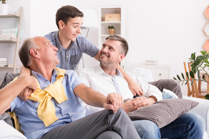 Boy hugging his family stock photography