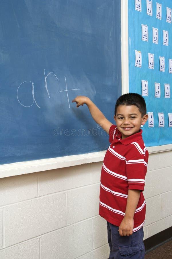 Free Boy In Front Of Blackboard Stock Image - 12528961