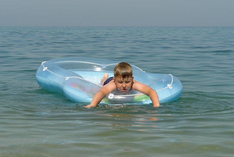 Download Boy in an inflatable boat stock image. Image of hope, child - 3143983