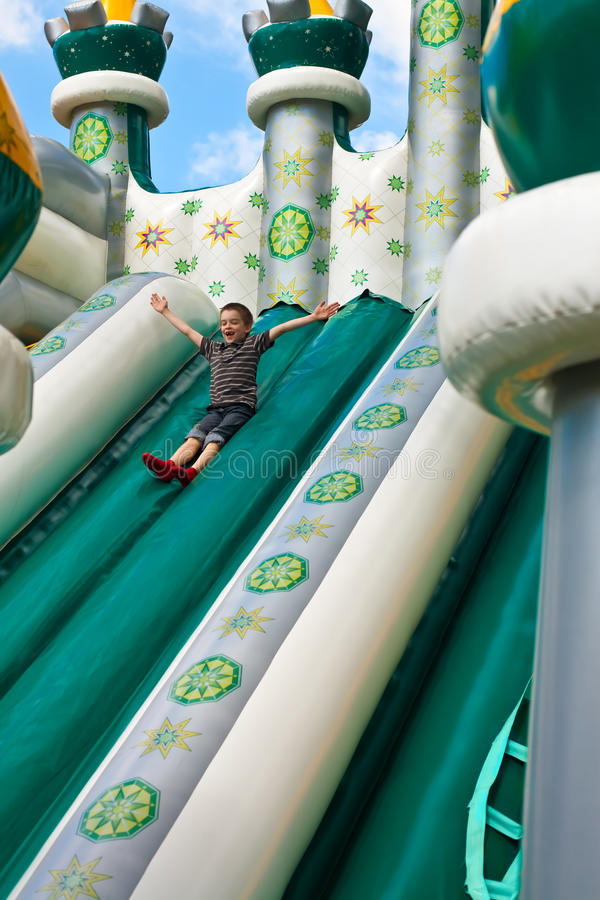 Download Boy in inflatable castle stock image. Image of playground - 17418477