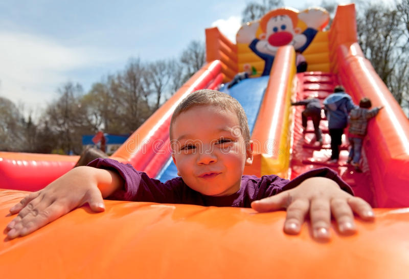 Boy Inflatable Slide Stock Images