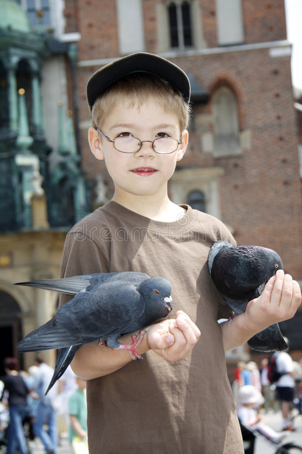 Free Boy Is Feeding The Birds Royalty Free Stock Photography - 5416827