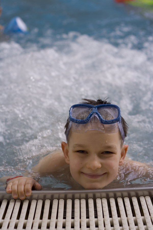 Boy in jacuzzi stock images