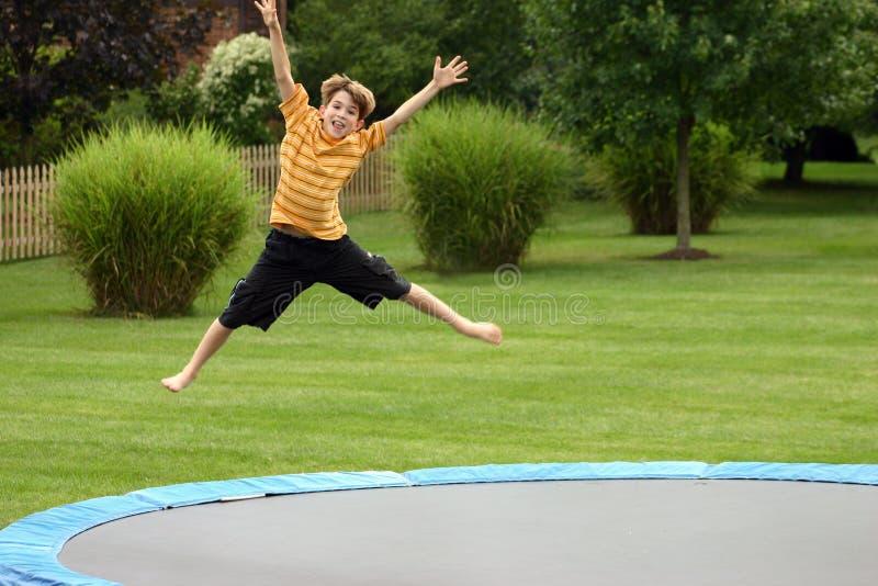 Boy Jumping stock photos