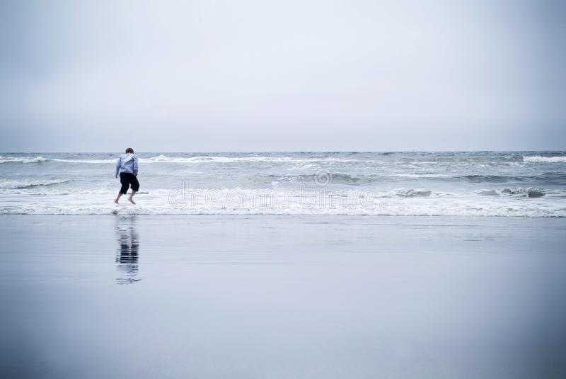 Boy jumping in ocean royalty free stock image