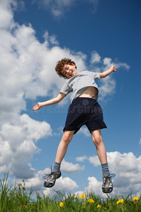 Download Boy jumping outdoor stock photo. Image of blue, enjoyment - 10857554