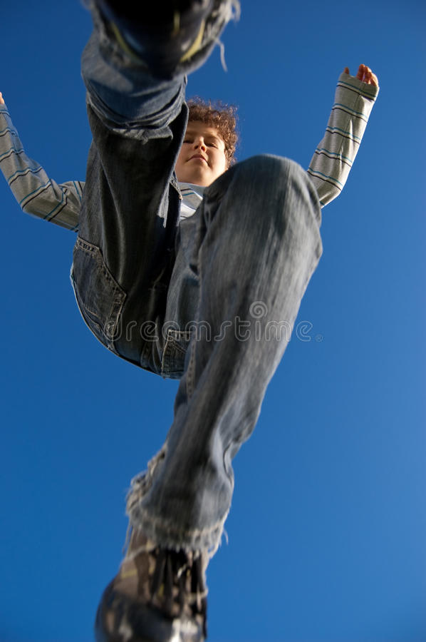 Boy jumping outdoor royalty free stock photography
