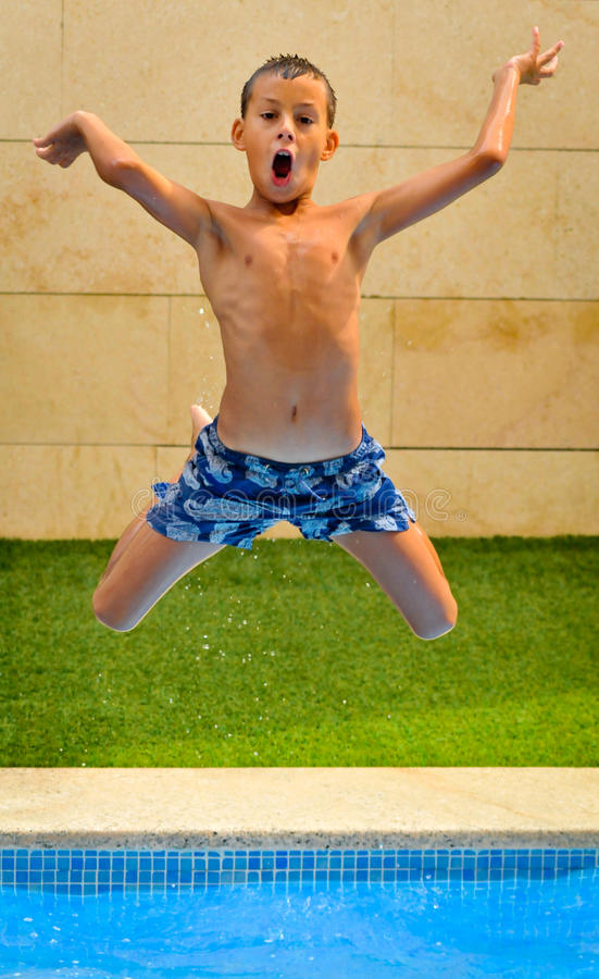 Download Boy Jumping Into Pool stock photo. Image of person, vacation - 26094218