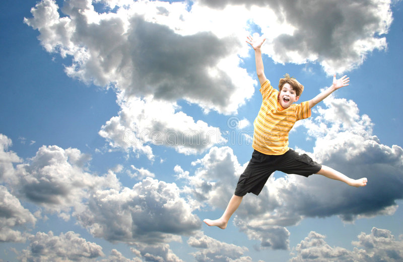 Boy Jumping in the Sky stock photography