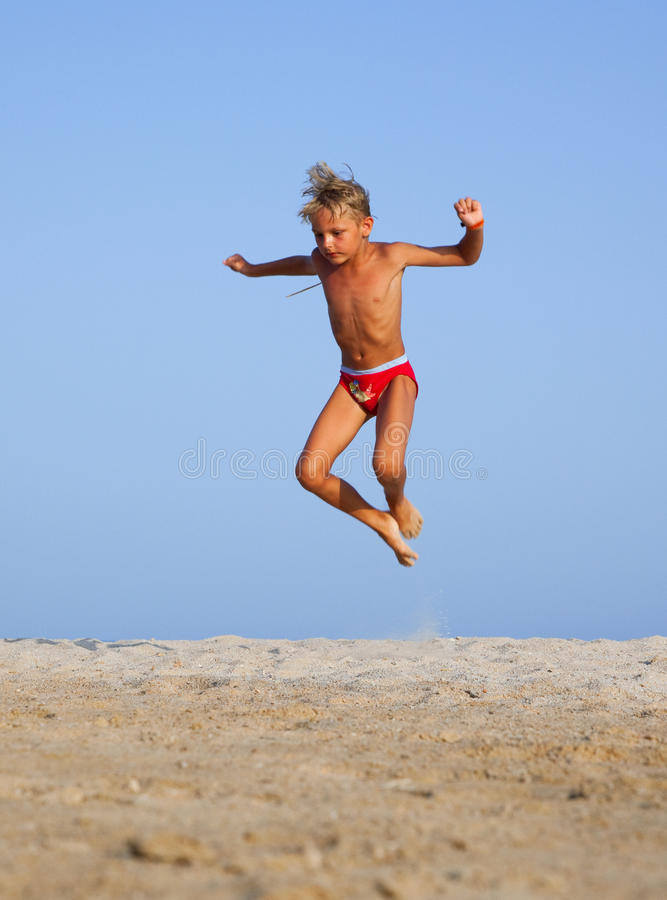 The Boy Jumps Stock Images