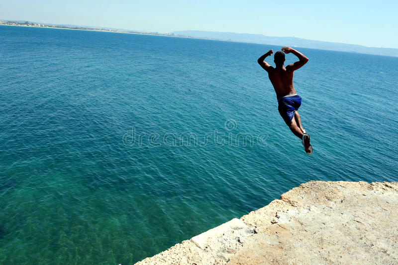 Boy jumps from the ancient walls of Acre stock photography