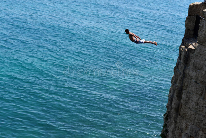 Boy jumps from the ancient walls of Acre royalty free stock photos