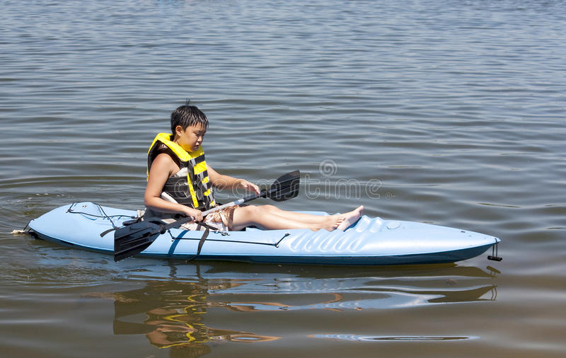 Boy in a Kayak stock images