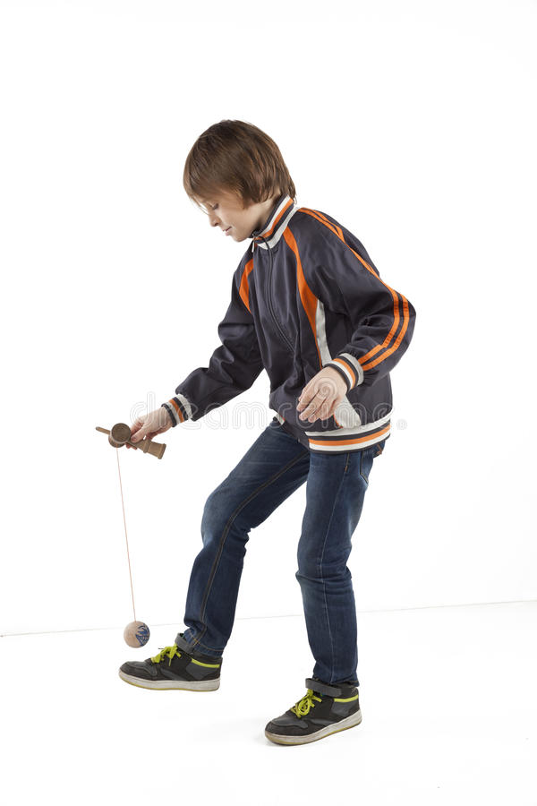 Boy with kendama royalty free stock photography